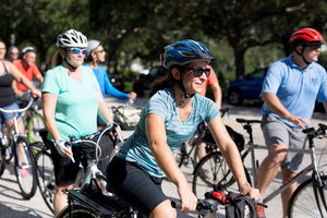 FCAN organizer leads Complete Streets bike ride.