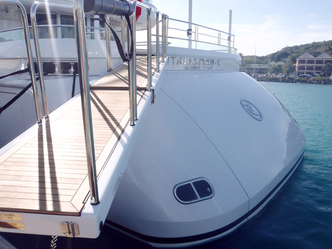 The passerelle rotates starboard in a Jack-Knife movement and stows behind the transom hatch . When the hatch is closed the name of the vessel is visible.