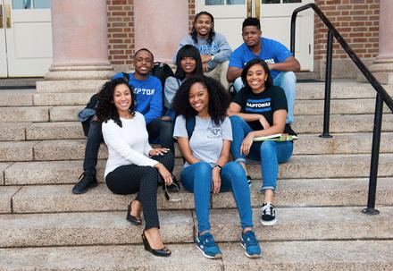 Hampton university students sitting on campus steps